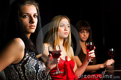 Three young women in a night bar