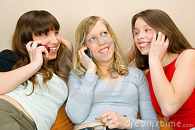 Three Young Women With Phones
