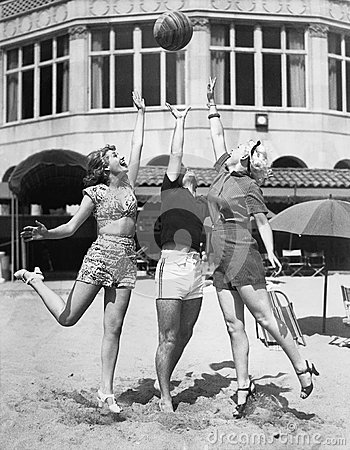 Free Three Young Women Playing With A Ball On The Beach Stock Photos - 52022793