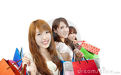 Three young women with shopping bag