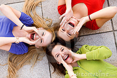 Three young women shouting