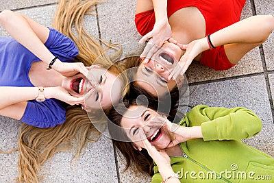 Three young women shouting