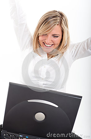 Thrilled young woman with laptop