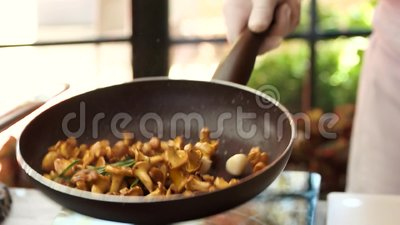 Throwing food in a pan. Chef frying mushrooms stock video footage