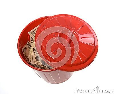 Throwing Money Away: Bills in Garbage Can
