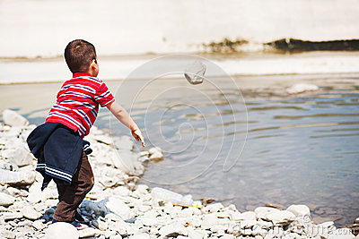 Throwing rock in water