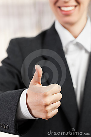 Thumb of a hand lifted upwards as success gesture