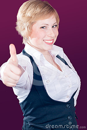 Thumb up & blond beautiful young woman smiling