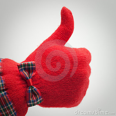 Thumb up in red glove over grey