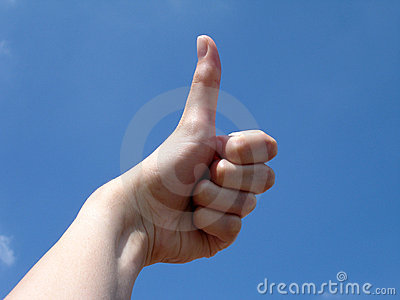 Thumbs up with sky background
