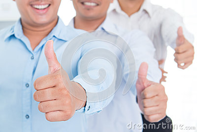 Thumbs up Southeast Asian business man
