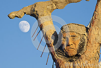 Thunder Mountain Statue and Moon Editorial Photo