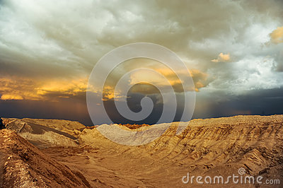 Thunderstorm developing over sand dune in Valle De La Luna in the Atacama Desert near San Pedro de Atacama, Chile