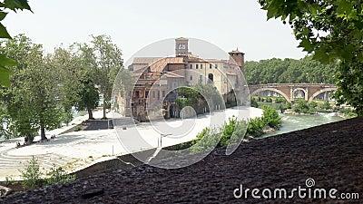 Tiber island. Bridge to the Tiber island on the Tiber river in Rome stock video