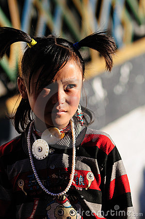 Tibet girl prayer in jokhang temple Editorial Photo