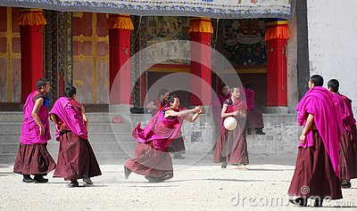Tibet monks play soccer Editorial Image