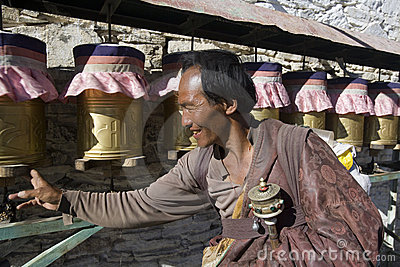Tibet - Tibetan pilgrim at a Buddhist Monastery Editorial Photo