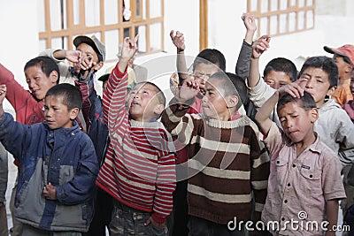 Tibetan children singing Editorial Stock Image