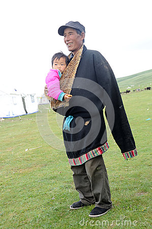 Tibetan grandpa and baby Editorial Stock Image