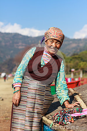 Free Tibetan Lady Selling Royalty Free Stock Photography - 71008177