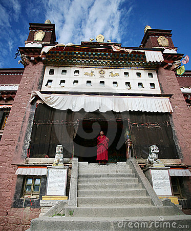 Tibetan lama at the door of monastery Editorial Stock Photo