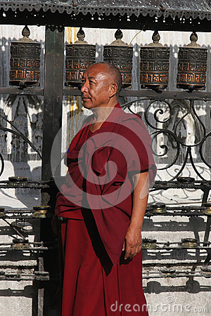 Tibetan Monk and Prayer Wheels Editorial Photography
