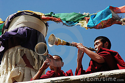 Tibetan monks blowing bugles Editorial Stock Image