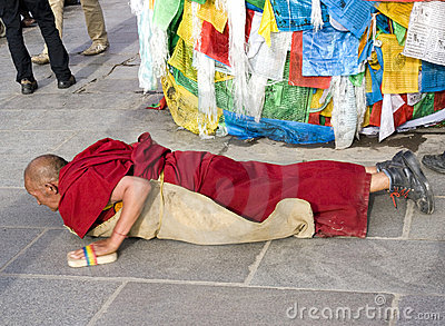 Tibetan outside a temple Editorial Stock Image