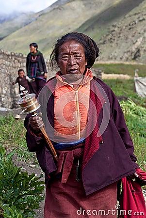 Tibetan pilgrim with prayer wheel, Nepal Editorial Photo