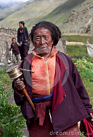 Tibetan pilgrim with prayer wheel, Nepal Editorial Photography