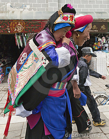 Tibetan Woman Carrying Child Editorial Photo