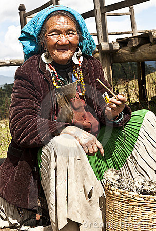 Tibetan Woman With Pipe Royalty Free Stock Photo - Image: 20716835