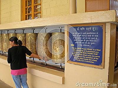 Tibetan Woman Praying Editorial Photography