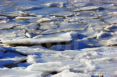 Tides breaking ice shoreline