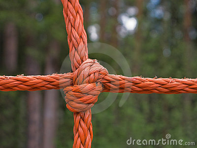 Tied up rope knot isolated at background