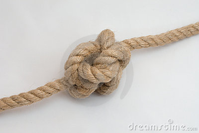 Tied up rope knot isolated on a white background