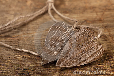 Tied wooned hearts on old  wood with sting