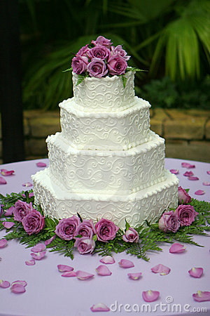 Free Tiered Wedding Cake With Purple Flowers Stock Image - 182351