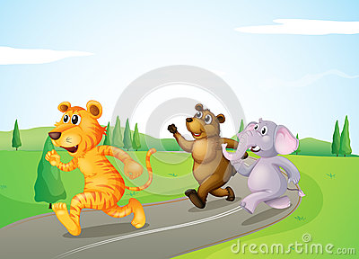 A tiger, a bear and an elephant running along the road