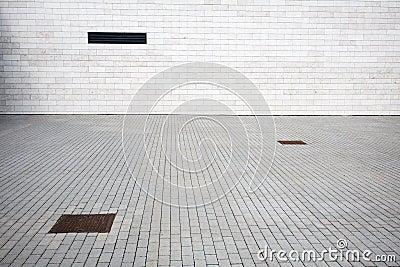 Tiled wall and paving