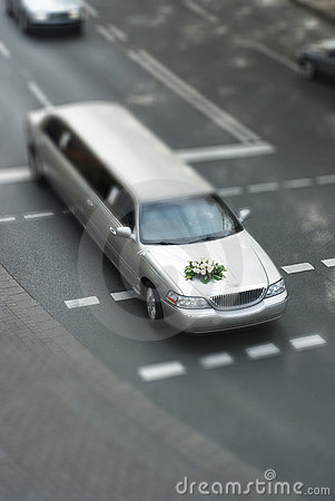 Tilt shift wedding limousine on street