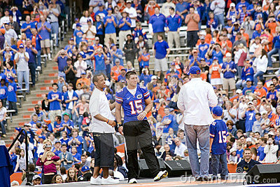 Tim Tebow with Chris Leak and Danny Wurfful w/ son Editorial Photo