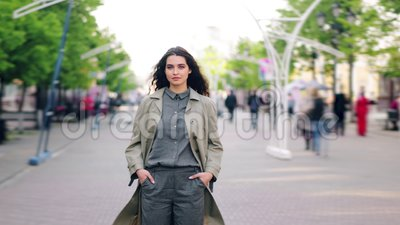 Time lapse portrait of young brunette standing in the street alone among crowd. Time lapse portrait of young pretty brunette standing in the street alone among stock video footage