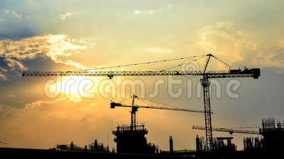 Time lapse sunset and silhouette crane in construction site. Time lapse sunset and silhouette crane working in construction site