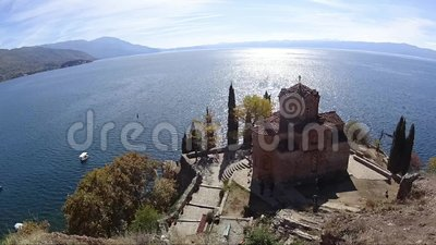 Time lapse of Sv Jovan Kaneo church in Ohrid with lake in background, Macedonia. Time lapse of Sv Jovan Kaneo church in Ohrid with lake in background on sunny stock video
