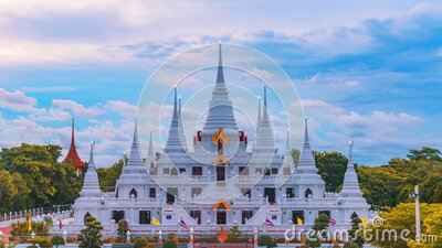 Time lapse of white Buddhist Pagoda with multiple spires at Wat Asokaram Temple in Samutprakan province, Thailand.  stock video footage