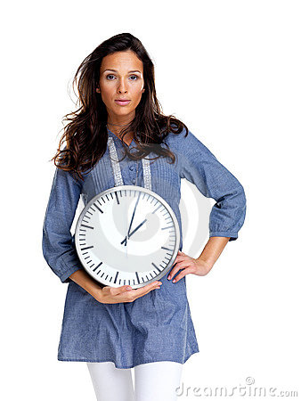 Time is money - Young woman standing with a clock