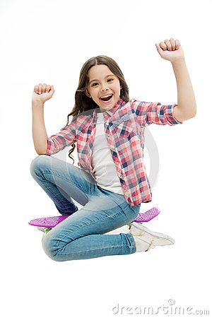 Time to ride. Kid girl excited sits penny board. Modern teen hobby. Girl happy face sit on penny board white background Stock Photo