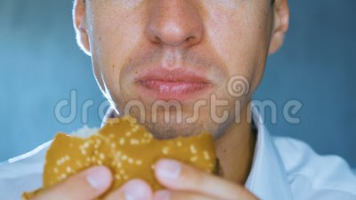 Timelapse of man eating a hamburger, close-up. Fast food. Cheeseburger, hamburger, sandwich. Timelapse of man eating a hamburger, close up. Fast food stock footage