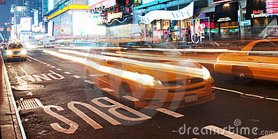 times square cabs coming to a stop Editorial Image